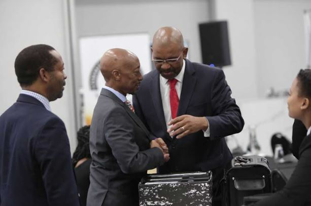 Advocate Dali Mpofu talks to former Sars commissioner Tom Moyane at the state capture inquiry in Parktown, Johannesburg.