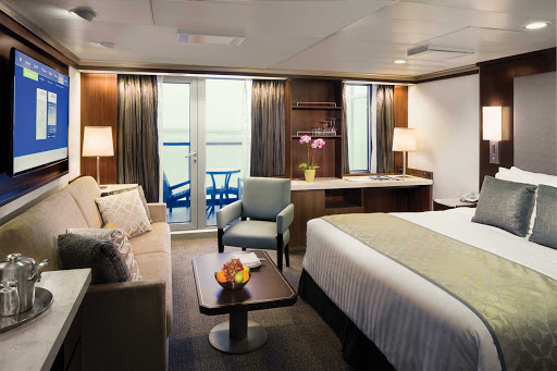 eurodam-Signature-Suite.jpg - The Signature Suite on Holland America's Eurodam features a queen bed, sitting area, sofa bed, private veranda and floor-to-ceiling window.