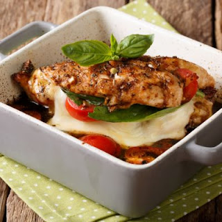 Balsamic Chicken Stuffed with Tomato Mozzarella and Spinach.