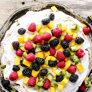 Cinnamon-Hazelnut Pavlova with Coconut Cream & Exotic Fruit.