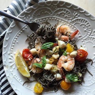 Seafood Black Bean Pasta with Roasted Tomatoes in Garlic Truffle Sauce.