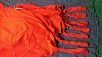 Photo: Red and misc color cook aprons