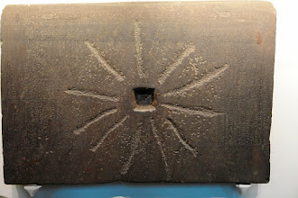 Photo: The inscription on this basalt block tells the story of the origin of the universe. Then it was remodeled for a millstone. British Museum.