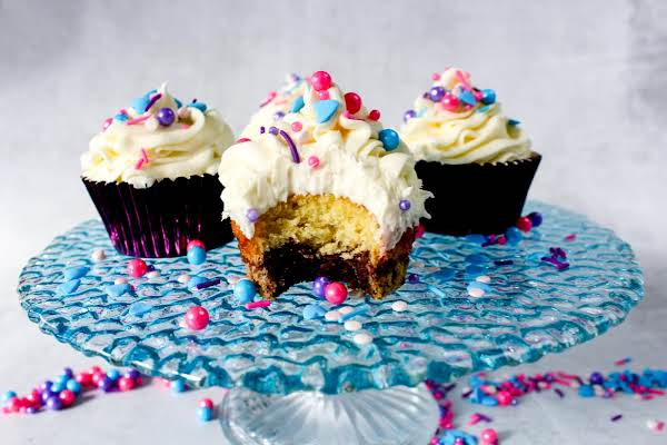 Inside Of A Yellow Cake And Brownie Topped Cupcake.
