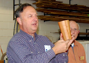 Photo: Stan Wellborn talks about one of the three cherry vessels he brought in.
