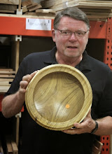 Photo: Richard Webster shows off the great grain and balance of his rimmed mulberry bowl.