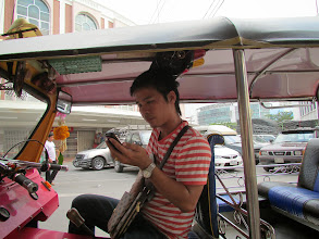 """Photo: My tuk tuk driver/scam artist who assisted in the """"Thai Fashion"""" con attempt. I took this shot when he wasn't looking."""