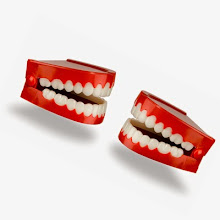 Photo: A pair of toy chattering teeth isolated on a white background with a clipping path
