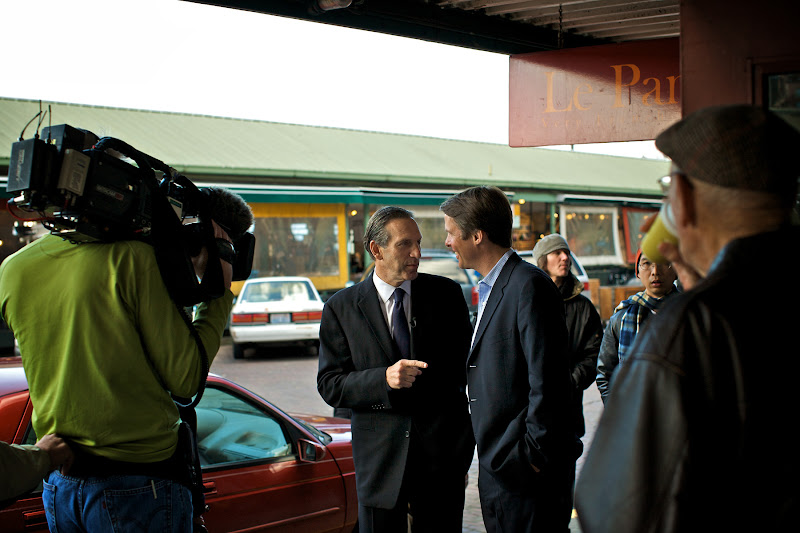 Photo: Howard Schultz walks and talks with a reporter along Pike Place - site of the first Starbucks store.