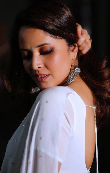 Tv anchor Anasuya in white transparent saree Navel Queens