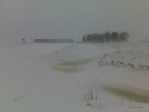 Photo: Sloten van 2 meter diep waaien vol tot aan de weg
