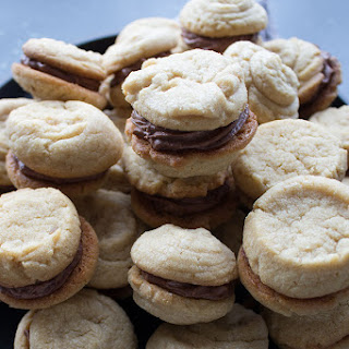 Peanut Butter Sandwich Cookies with Malted Chocolate Buttercream Filling.
