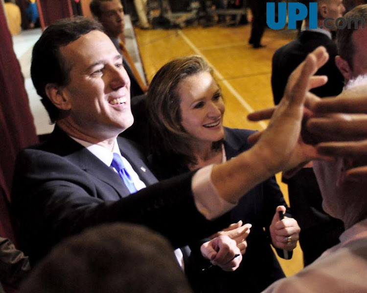 Photo: Republican presidential hopeful Rick Santorum and his wife Karen Santorum greet their supporters as they depart the Super Tuesday Election Night Party in the gymnasium of the Steubenville High School in Steubenville, Ohio. UPI/Archie Carpenter