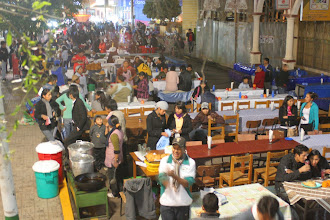 Photo: All of those tables are people selling the exact same stuff as us - api and pasteles