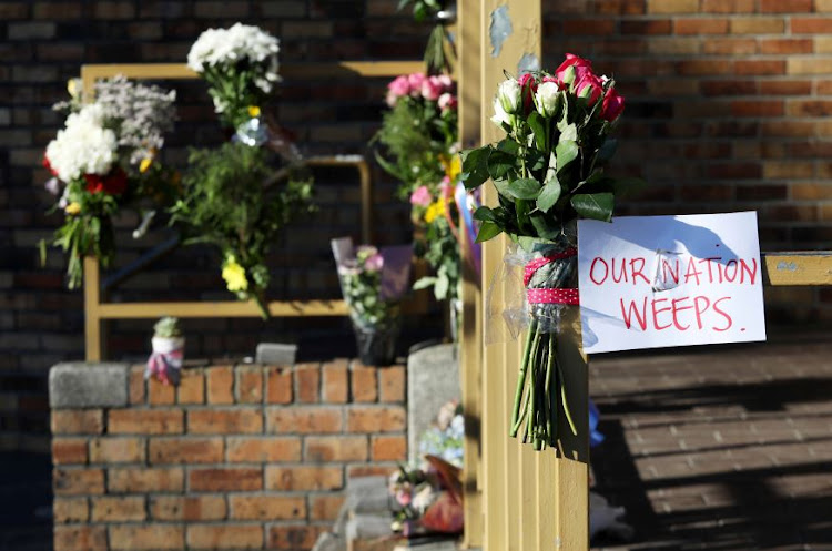 Flowers outside the Post Office in Claremont in the Western Cape where Uyinene Mrwetyana was raped and killed.