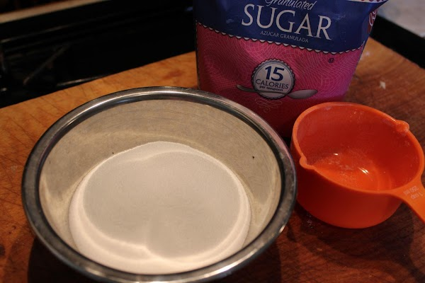 Put 1 cup of sugar in a shallow bowl.