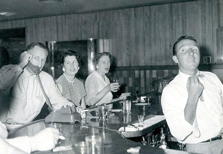 Baci (right) tending bar at Sullivan Creek dinner house, 1956