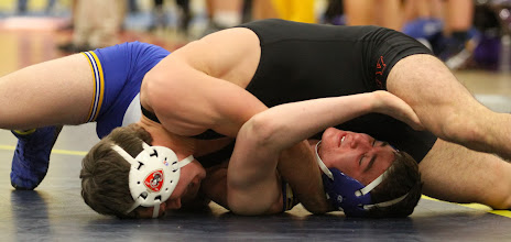 Photo: 170 Peter Andreotti (Chicago Marist) over Evan Foster (St. Michael-Albertville) TF 15-0. Photo by Mark Beshey