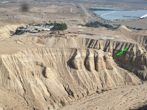 Photo: The Qumran National Park, as seen from a nearby mountain. The arrow points to the location of cave # 4, where the majority of the Dead Sea Scrolls were found.