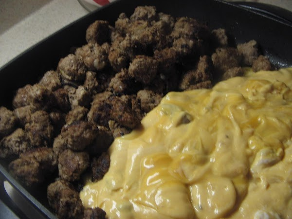 Scrape bottom of pan to loosen  drippings..Scoot the  meatballs to one side...