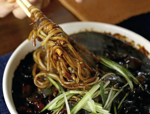 Colour me black: Black bean noodles, or jjajangmyeon are popular in South Korea. Picture: EPICURIOUS