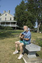 Photo: Joe Manley or Brooklyn, NY relaxes with his guitar while visiting Kingland Bay State Park. Photo by Karen Pike