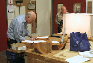 Photo: Bill Long bids on some nicely processed green wood while Mike Colella does the Gallery photography.