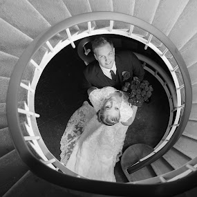 Just married by Sigurður Brynjarsson - Wedding Bride & Groom ( stairwell, hold, newlywed, white, round, circle, married, stairs, dress, woman, happy, suit, couple, bride, groom, marry, man, black )