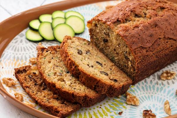 Zucchini Pineapple Walnut Bread Sliced And On A Plate.