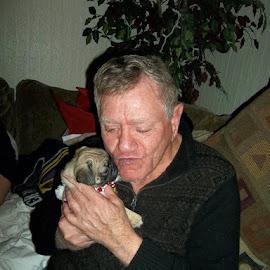 Elderly Man Kissing Puppy by Kristine Nicholas - Novices Only Street & Candid ( person, old, pup, loved, people, pug, elder, kiss, puppy, men, elderly, dog, man,  )