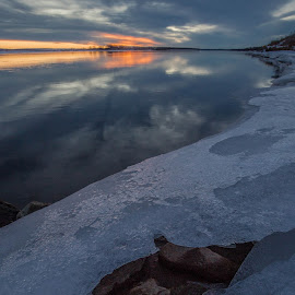 Sunset on the Rocks by Laura Gardner - Nature Up Close Water ( outdoors, sunset, winter, ice, north dakota, water )