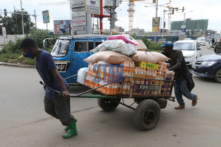 Cart pushers ferry food into Eastleigh in Nairobi on May 21, 2020.