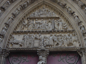 Photo: The lintel above the door served its typical purpose in the Middle Ages: a pictorial representation of Biblical events for the illiterate majority of the people. This one contains two stories: the Nativity on the lower level, and a 13th century play about a Bishop Theophile on the upper two.
