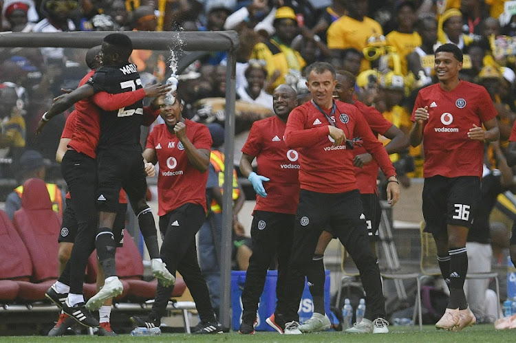 Innocent Maela of Orlando Pirates celebrates his goal with Orlando Pirates coach Milutin 'Micho' Sredojevic and Rulani Mokwena during the Absa Premiership match between Orlando Pirates and Kaizer Chiefs at FNB Stadium on October 27, 2018 in Johannesburg, South Africa.