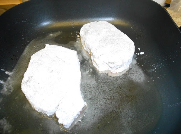 Place pork chops on flat surface. Add salt and pepper, then coat chops on...