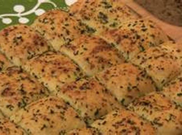 Herb garlic bread  1 loaf defrosted bread 1 tbls garlic powder, 1 tablespoon Italian herbs  Mix...