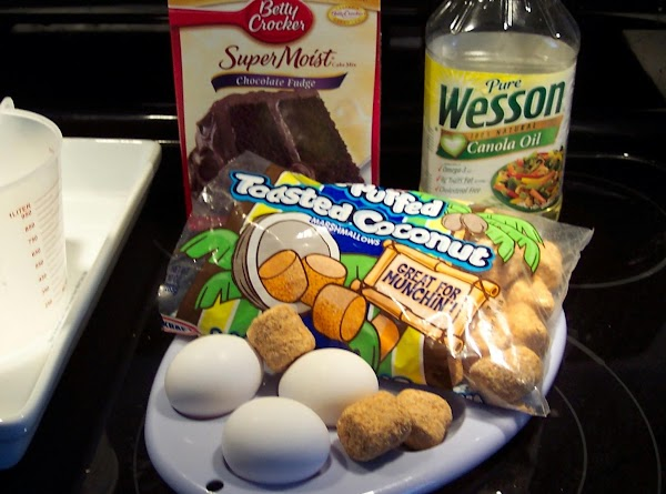 Mix cake in a bowl, using directions  and ingredients on the box.  Set...