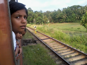 Photo: Sisters looking outside from the train, on the way to Peradeniya