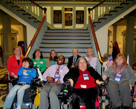 Photo: Some of the advocates gathered for Disability Day at Legislative Hall on 3.25.15 smile with Senator Nicole Poore after the introduction of the ADA 25 Proclamation in the Senate. Front row L-R: Brigitte Hancharick, Emmanuel Jenkins, Jamie Wolfe, Daniese McMullin-Powell. Back Row L-R:Senator Nicole Poore, Terri Hancharick, Wendy Strauss, Brian Hartman, Esq. and Pat Maichle.