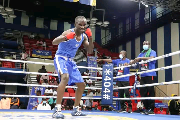Kenya's Nick Okoth celebrates after being declared winner of one of the bouts at the Africa Zone 3 Boxing Championship in Kinshasa, DRC.