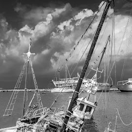 Small shipwreck on beach by Dejan Vuckovic - Black & White Landscapes ( damaged, old, bermuda, rusty, transportation, travel, storm, danger, sky, nature, rope, metal, dark, maritime, vessel, white, horizon, sink, turquoise, bay, nautical, abandoned, shore, coral, sunken, colorful, ship, tropical, ocean, beauty, landscape, coastline, caribbean, coast, sinking, shipwreck, water, marine, sunk, reef, vintage, wreck, beautiful, tropic, sea, scenic, seascape, boat, paradise, blue, background, outdoor, cloud, summer, brown, scenery,  )