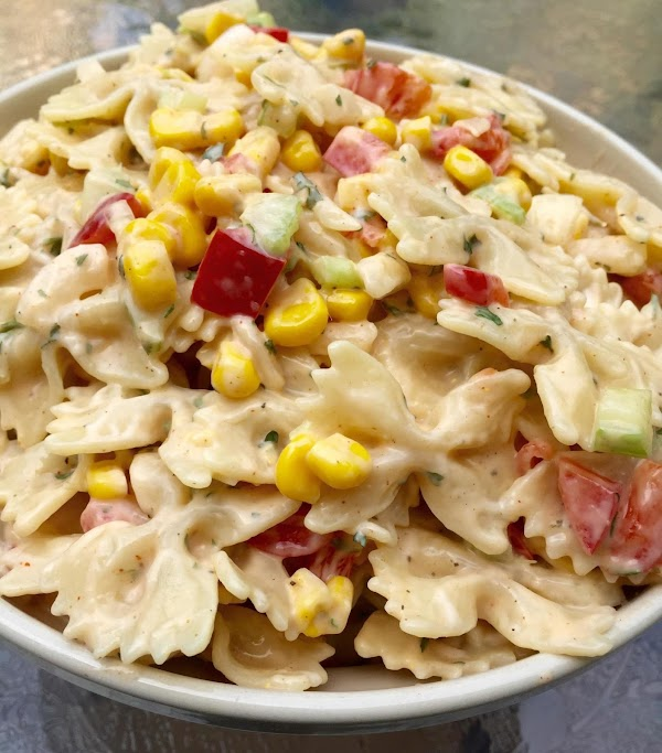 Add the chopped pepper onions,  corn and celery to the mayonnaise mixture. Add...
