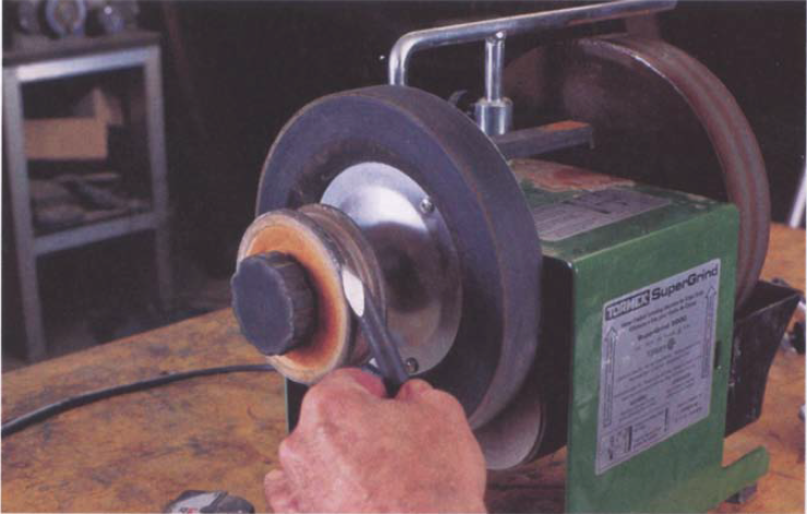For the inside of gouges, the optional profile honing strop on a Tormek machine mounts outboard on the normal strop supplied with the machine.