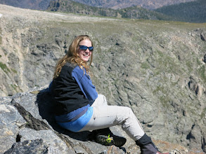 Photo: Steph looking happy to be on her first Rocky Mountain summit. Photo by Dave Socky