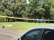 A forensic team combs for clues at the spot where Grade 11 pupil Kulani Mathebula was fatally stabbed on Wednesday.