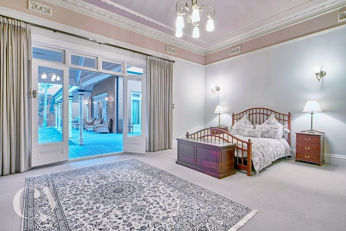 The master suite featuring an enormous bedroom