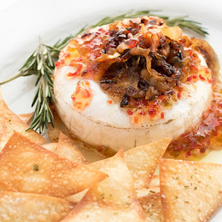 Baked Brie with Caramelized Onions and Pepper Jelly.