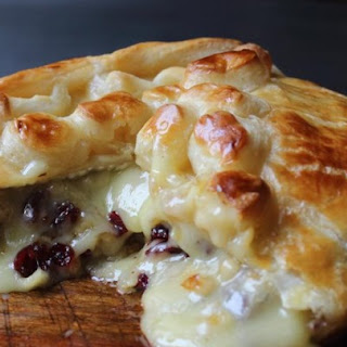 Baked Stuffed Brie with Cranberries & Walnuts.