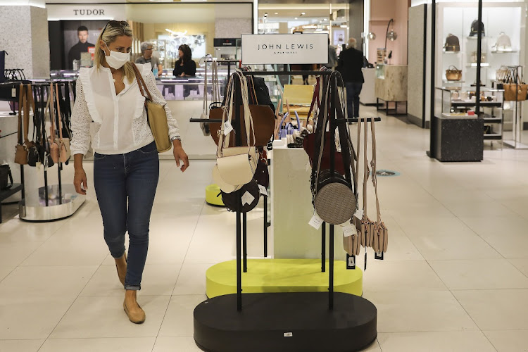 A customer wearing a protective face mask browses handbags in the womenswear department inside a John Lewis Partnership Plc department store in London, U.K., on Thursday, July 23, 2020. Picture: SIMON DAWSON/BLOOMBERG