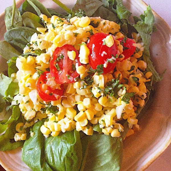Serve immediately over a bed of fresh baby greens or spinach leaves. Corn salad...